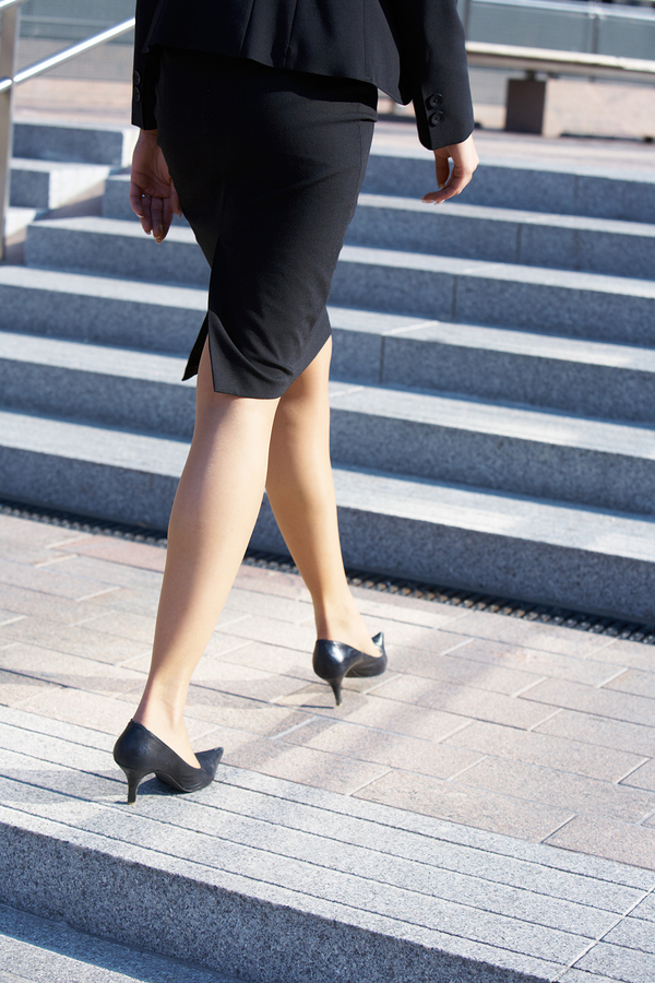 Businesswoman Walking On Stairway