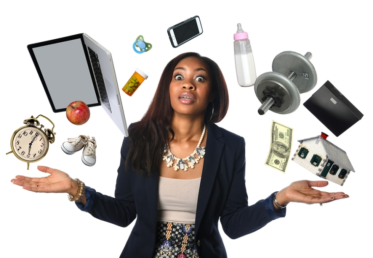 African American businesswoman juggling many objects and feeling