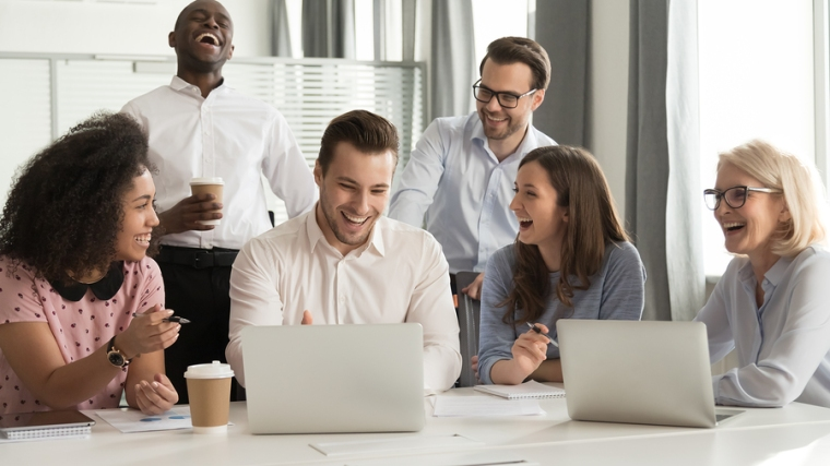 Happy Diverse Office Workers Team Laughing Together At Group Mee